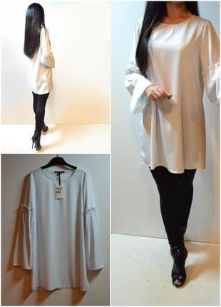 Стильная длинная блуза с красивыми рукавами