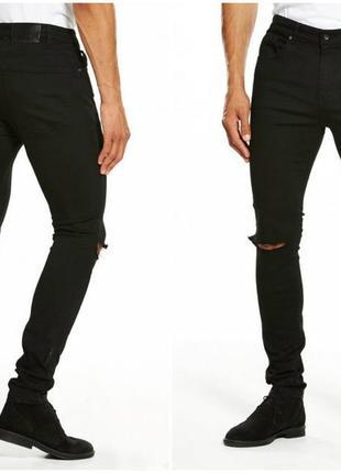 Мужские новые черные джинсы с рваными коленями