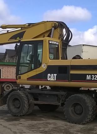 Услуги Экскаватора CAT M320) с гидромолотом в Хмельницком