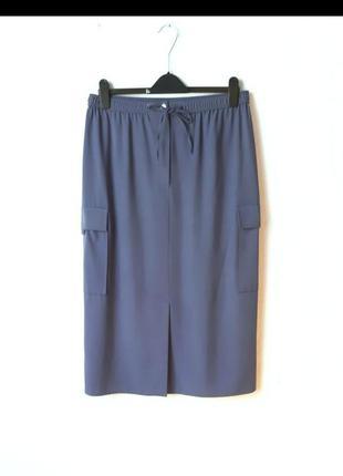 Стильная юбка миди с карманами