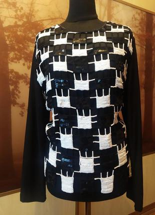 Трикотажная блузка с клетками-паетками