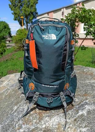 Рюкзак The North Face карскасной спинкой и дождевиком