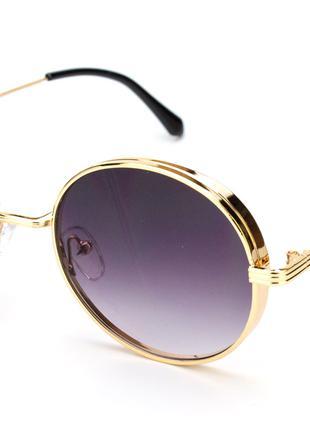 Очки солнцезащитные  в золотой оправе