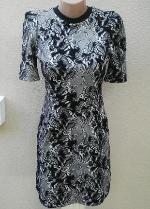 Платье с замочком по спинке,из трикотажной,фактурной ткани,хло...