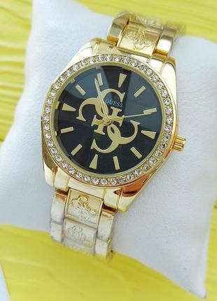 Женские наручные часы золотистые с черным циферблатом