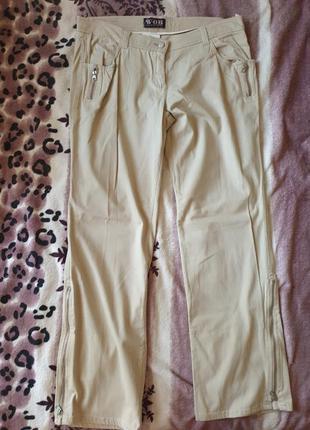 Женские брюки джинсы песочного бежевого цвета с молниями 52 р.