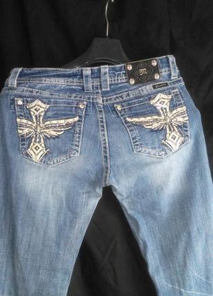Классные фирменные джинсы ( на карманах есть стразы  )