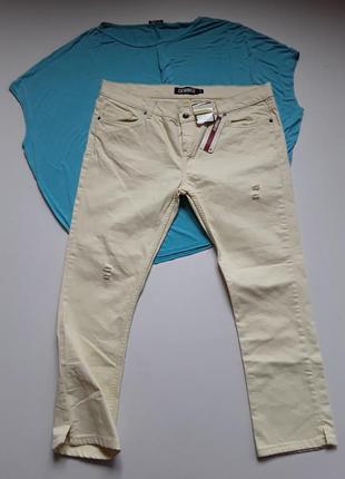 Желтые  укороченые джинсы слим