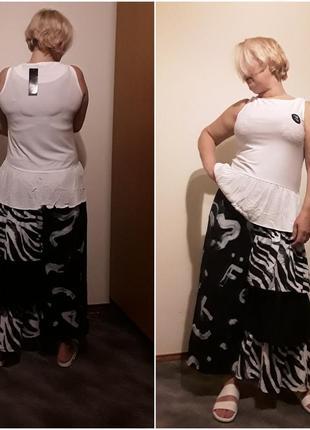 Трикотажная блузка с баской