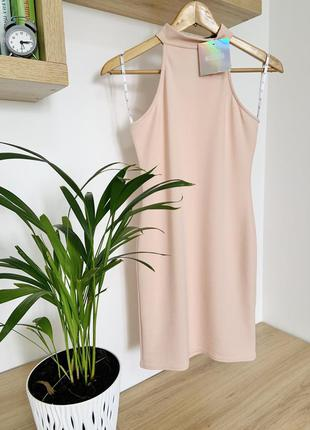 Розовое облегающее мини платье из текстурной трикотажной ткани...