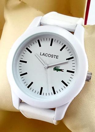 Кварцевые наручные часы lacoste белого цвета с белым циферблат...