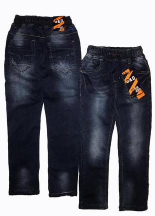 Утеплённые зауженные джинсы на флисе