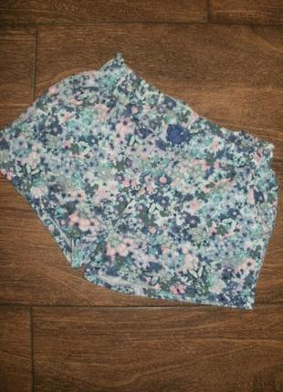 Трикотажные шорты на 9-10 лет с цветочным рисунком