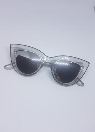 Женские солнцезащитные очки «кошачий глаз» серебристые в прозр...