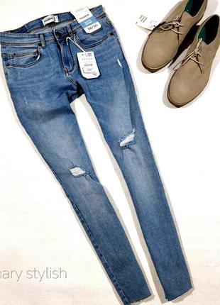 Новые мужские джинсы с рваностями