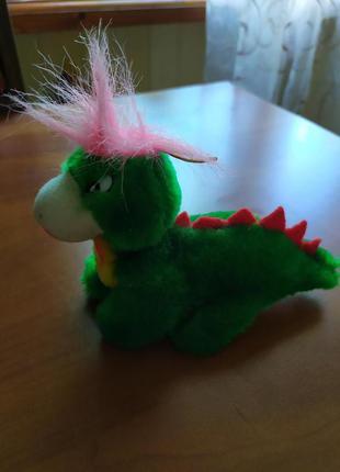 Игрушечный динозаврик