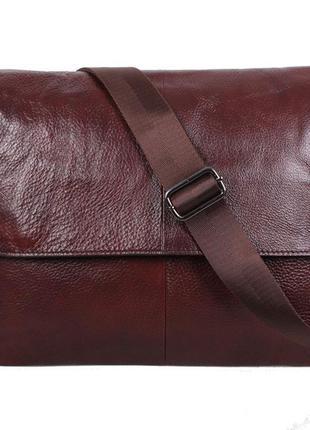 Вместительная кожаная сумка на длинной ручке