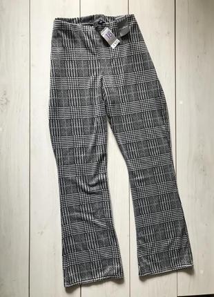 Серые трикотажные брюки в клетку с высокой посадкой