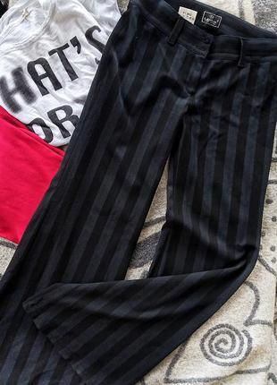 Стрейчевые брюки полоска