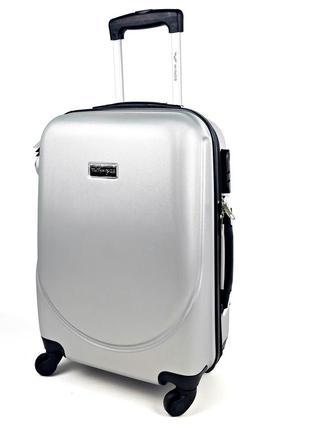 Большой пластиковый чемодан на колесах wingsсерого цвета