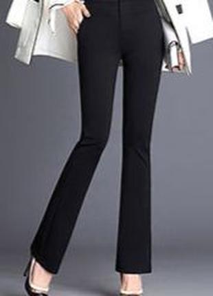 Женские стрейчевые брюки-клеш с высокой талией.