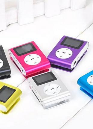 Mini MP3 В виде клипсы с разьемом под флешку