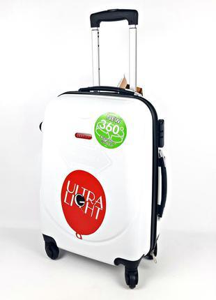 Большой пластиковый четырехколесный чемодан на колесах gravitt...