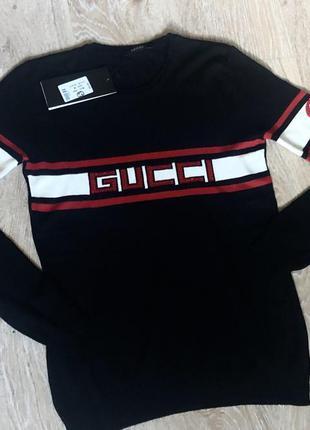 Новый женский свитер с модным логотипом.