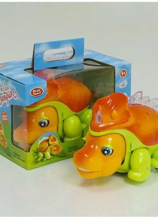 Музыкальная развив. игрушка PlaySmart Счастливый Динозаврик 0911
