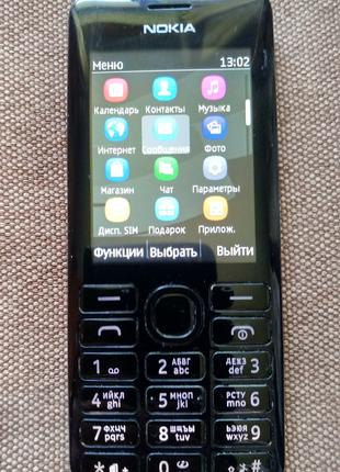Телефон Nokia 206 Dual SIM black. Два чехла, наушники.