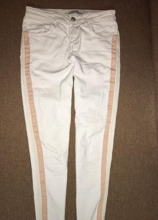 Белые джинсы скинни Жіночі джинси