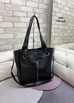 Женская сумка черного цвета. помещается формат а4