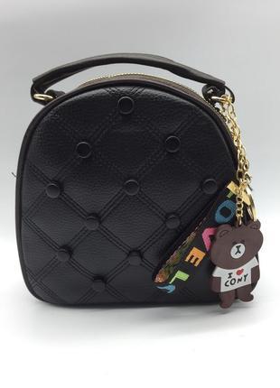 Женская сумка через плечо.