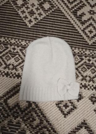 Тоненькая шапка с бантиком от divided by h&m