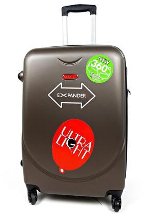 Средний четырехколесный чемодан пластиковый на колесах gravitt...