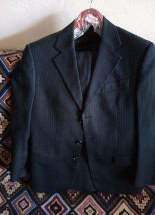 Школьный пиджак и брюки.Костюм тёмно-синий.