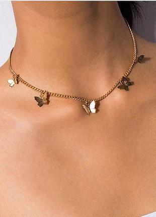 Цепочка ожерелье с подвесками бабочка золотистого цвета