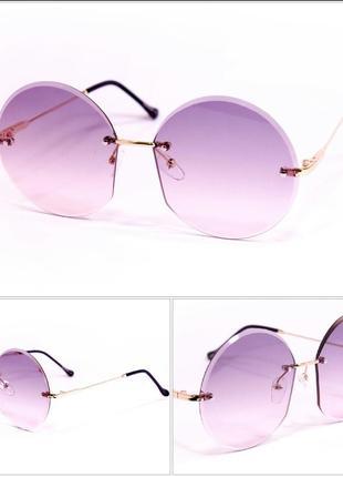 Очки солнцезащитные женские круглые