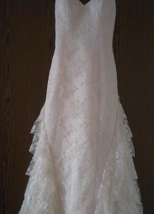Свадебное платье покупалось в свадебном салоне love story.