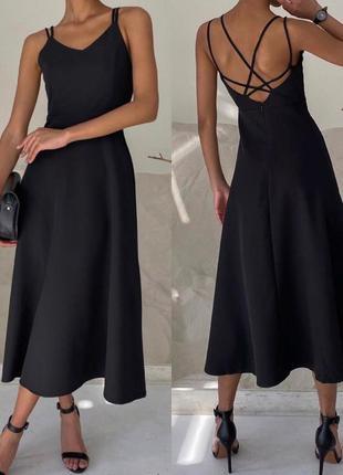 Элегантное платье из оригинальной спинкой