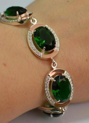 Серебряный браслет с золотом и зелеными фианитами бр21
