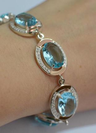 Серебряный браслет с золотом и нежно-голубыми фианитами бр21