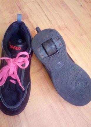 Роликовые кроссовки,кеды на колесиках