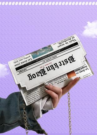 Стильная женская сумка-клатч в газетном принте