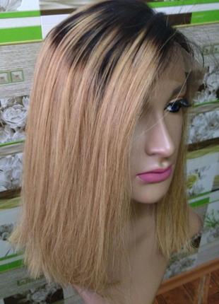Парик на сетке из натуральных волос.