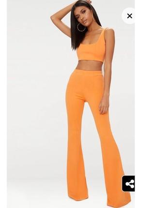 Расклешенные брюки бандажные оранжевые