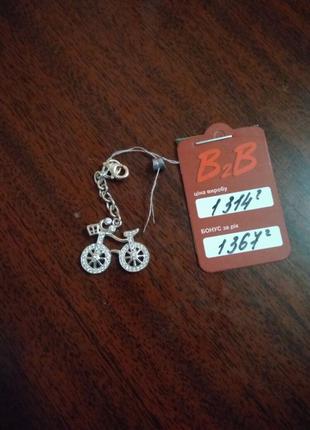 Брелок велосипед из серебра со вставкой куб. циркония