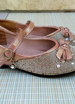 Нарядные розовые туфельки с бантиком