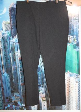 Класичесские зауженные брюки с манжетами и карманами