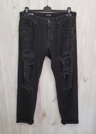 Мужские чёрные рваные джинсы
